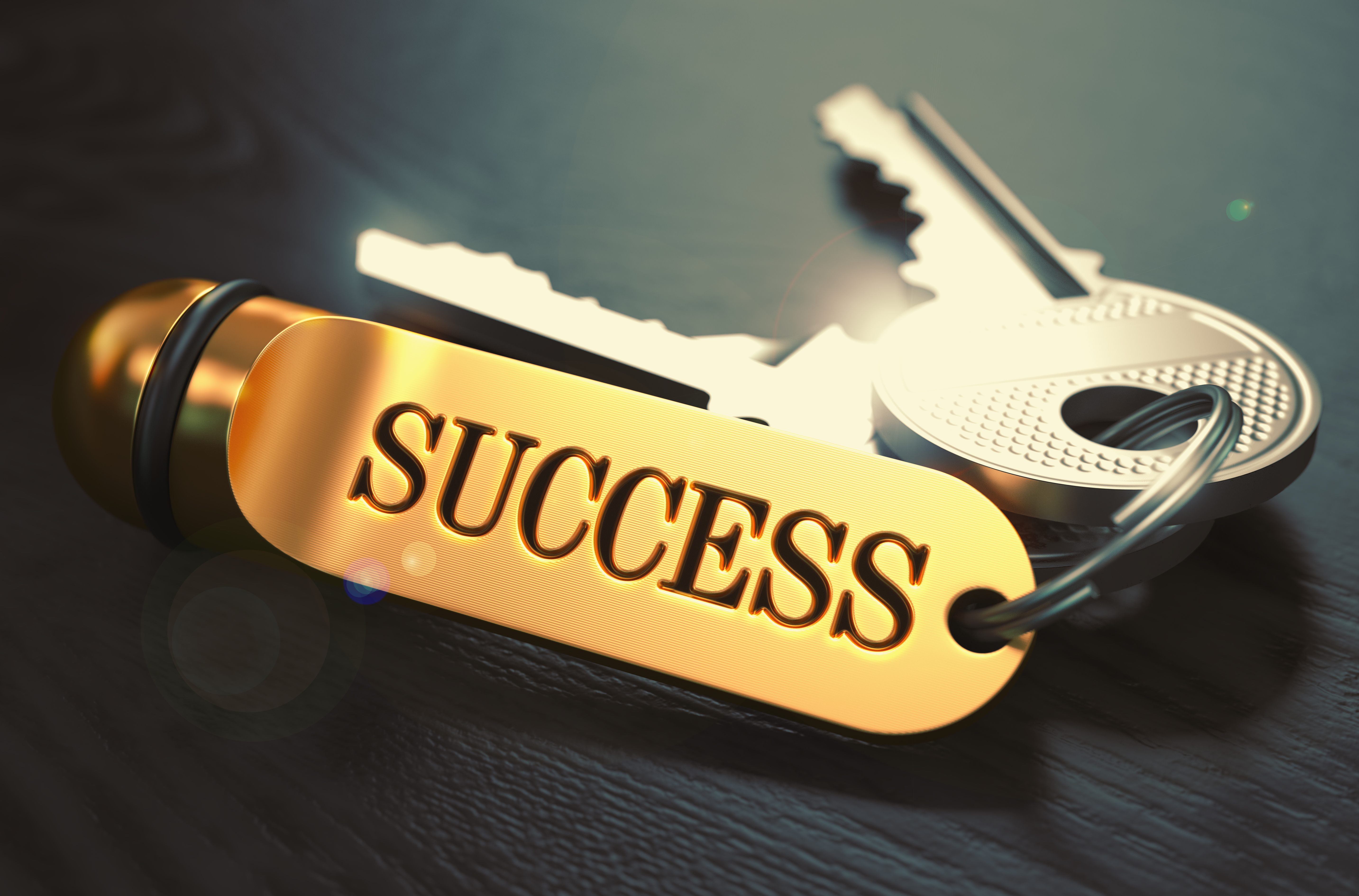 Keys to Success. Concept on Golden Keychain.